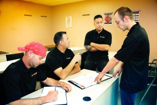 Candid picture of Linamar apprentices taken in Guelph by commercial photographer Trina Koster.