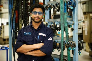 Editorial portrait of a Linamar employee taken in an industrial setting for commercial purposes.