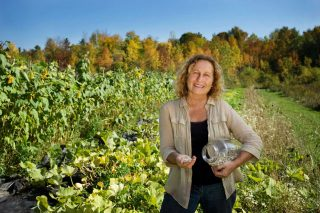 Commercial photographer Trina Koster captures image of organic seed grower for trade show display in Ontario.
