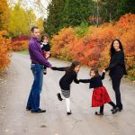 Fall photography of a young family at the University of Guelph's Arboretum.