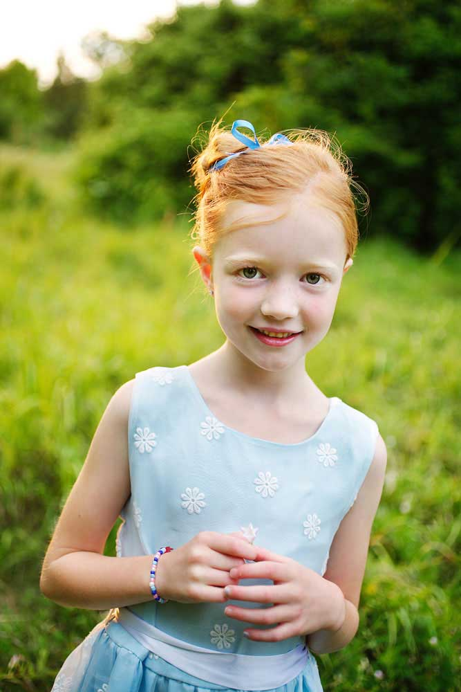 Redhead girl at the Arboretum Centre, photographed by portrait artist Trina Koster.