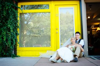 Wedding portrait photography of a couple in front of a yellow door.