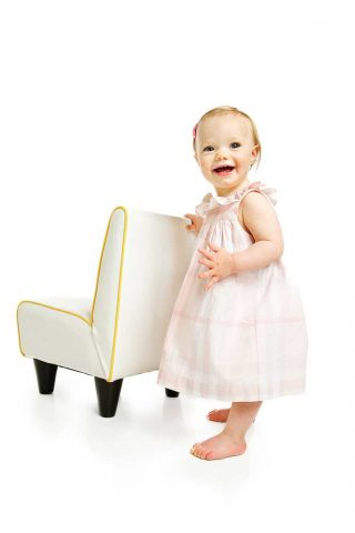 A ten month old baby having her portrait photograph taken in a studio in Guelph, Ontario.
