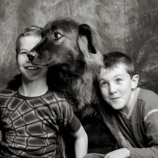 Image of kids and their dog taken with pet photography lighting in a Guelph studio.