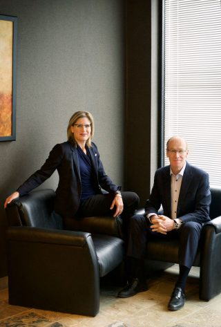 Professional business headshots of two lawyers from Smith Valeriote law firm in Guelph.