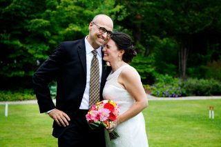 Husband and wife on the field, captured by Langdon Hall wedding photographed Trina Koster.
