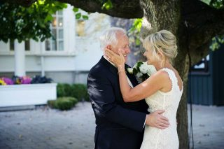 A bride with her father outside, taken by Langdon Hall wedding photographer Trina Koster.