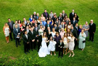 Wedding group photograph of all the guests taken from the balcony of the Orchard Suite, Langdon Hall.