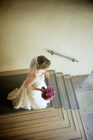 Bride walking down steps toward Firshade Room & Hall.