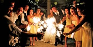 Guests holding sparklers and partying at a Guelph wedding reception.