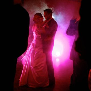 Wedding dance with smoke and pink light at a venue in Guelph.