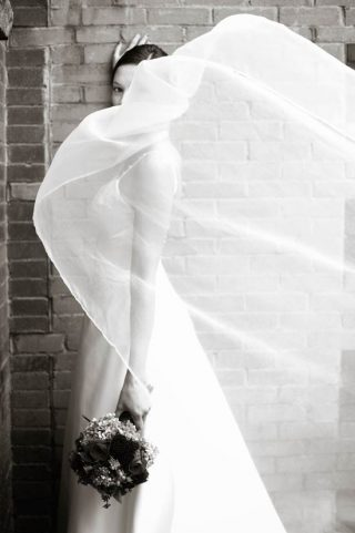 Black and white photo of bride taken by Guelph wedding photographer.