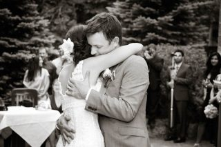 Wedding photographer Trina Koster captures a black and white photo of newlywed couple hugging.
