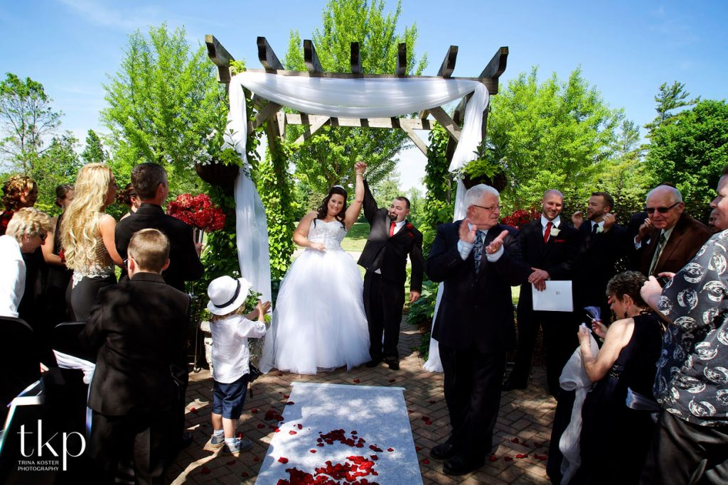 ceremony with flowers at cutten fields guelph