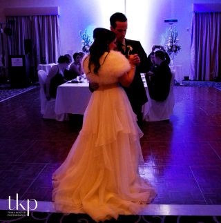 bride and groom dancing at delta hotel