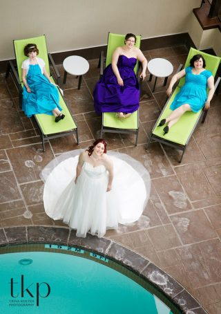 Bridesmaids and bride by pool in holiday inn